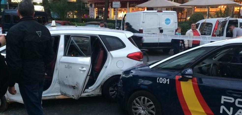 Loca fuga y tiroteo de un atracador en un taxi en Valencia