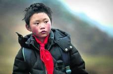Una vida cálida para Wang, el niño chino que llega al colegio con el pelo helado