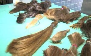 Alzira dona 5 kilos de pelo para las pacientes que sufren cáncer
