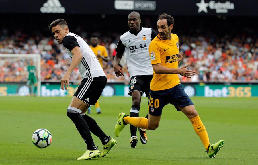 Fotos del partido entre el Valencia CF y el Atlético de Madrid en Mestalla