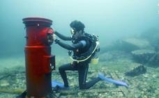 Enviar cartas desde un buzón de correos bajo el mar