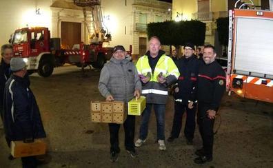 Rescatan a siete palomos deportivos en el campanario de la iglesia de Sollana
