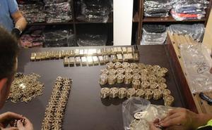 La Policía Nacional interviene 10.500 artículos falsificados ocultos en una nave en Manises