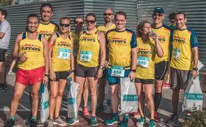 Diego Robles e Isabel Checa. ganadores de la Sanitas Marca Running Series de Valencia 2018