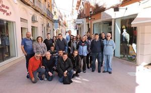 Los comerciantes decoran la calle Cop con la ayuda del Tapis