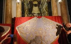 El manto de los dragones de la Virgen recupera su esplendor