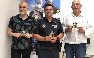 La Policía Local de Dénia se suma a 'Escuts solidaris' para recaudar fondos para la lucha contra el cáncer infantil
